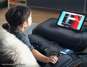 neurofeedback-training-child-doing-a-neuroptimal-session-at-home
