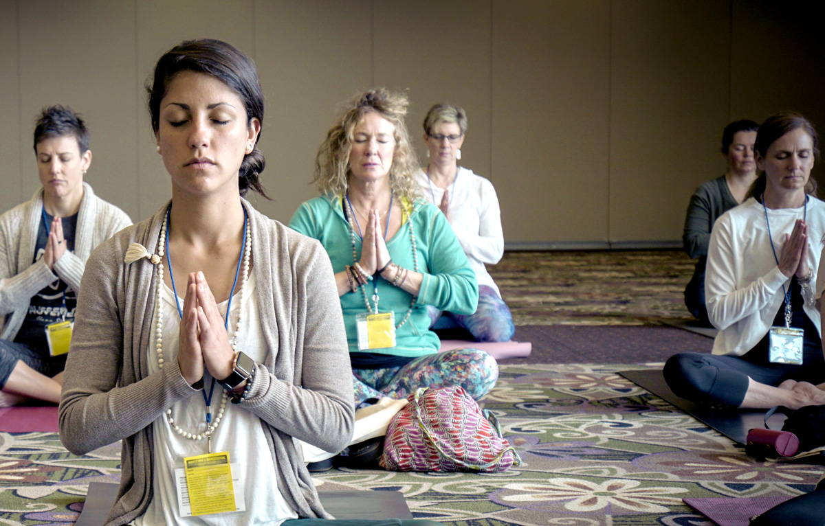yoga--group-shot-young-and-old-meditating