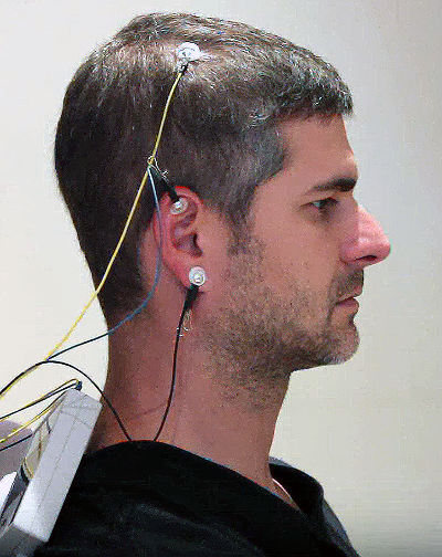 man with the neuroptimal sensors on scalp and ear read your brainwaves nothing is added to your brain