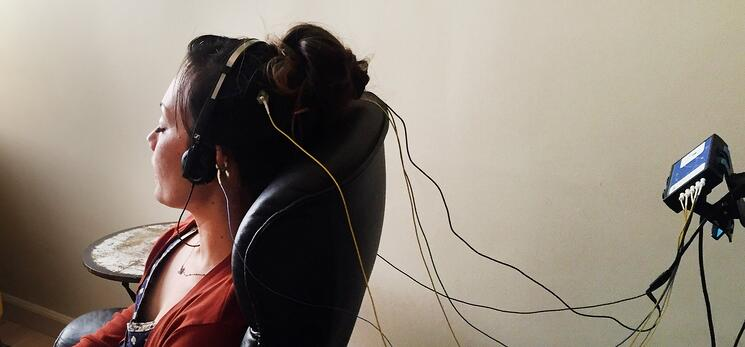 woman sitting in a chair during a neuroptimal neurofeedback session