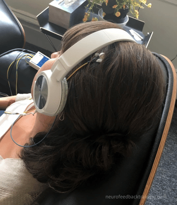 woman listening to music during neuroptimal session