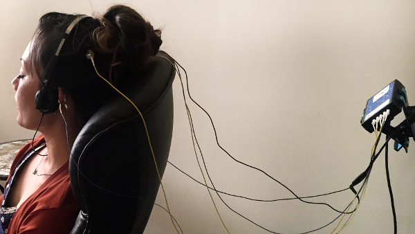 eeg sensors attached to scalp and ears duing a neuroptimal neurofeedback session